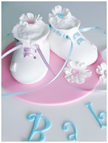 white booties baby shower cake