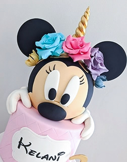 Minnie Mouse Unicorn birthday cake for a girl