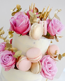 Semi naked cake with roses and macaroons