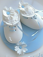 White booties Christening cake for boys