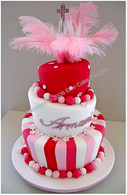 Christening cake with feathers and cross