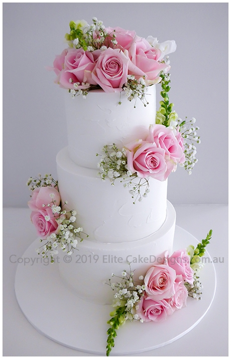 Rustic wedding cake with pink roses in Hunter Valley